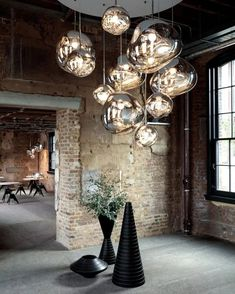 A corner of the Coal Office, our London home, featuring a massive cluster of MELT pendants. Original post by Tom Dixon Lampe, Interior Lighting, Luxury Interior, Suspension Tom Dixon, Tom Dixon Melt, Tom Dixon Lighting, Cluster Lights, Suspension Design, Modern Dining Table
