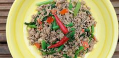 A spicy Thai recipe: Pad Ka-Prao - is a spicy basil stir fry with minced pork served with an egg on top. Quick, easy & affordable recipe.