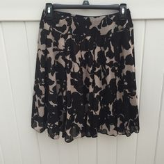 Black and Tan Floral Skirt Cute floral flowy skirt by INC. Size small INC International Concepts Skirts Midi