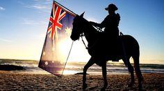 BBC WWI - Why Australia celebrates Gallipoli - A soldier on a horse holding the Australian flag on a beach