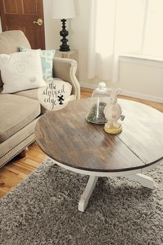 Fixer Upper style coffee table with a rustic top and gray bottom. Pedestal table cut down for a coffee table size.  Facebook.com/thechippededge
