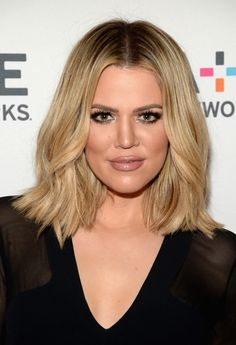 Khloé's honey blonde bob, brows, and smoky eye are perfect