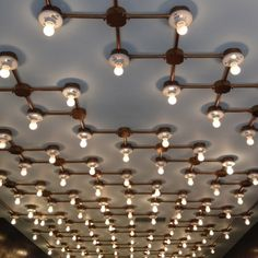 Custom light installation by Architecture at Large for UBIQ, a sneaker store in Rittenhouse Square, Philadelphia