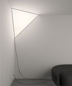 g          CORNER LIGHT          I really like this design…the way it uses space and becomes part of the room. via Peter Bristol