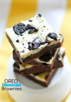 Oreo Cheesecake Brownies - fudgy brownies with a layer of cookies and cream cheesecake.