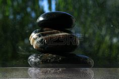Zen stones on water background picture Stock Photo