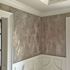 Wall finish for a dining room with three different custom tinted Modern Masters Venetian Plaster hues troweled over bronze foil that was already applied to the wall. It was then glazed with a dark brown. | Designer: Amy Wagner | Decorative Artistry by Linda Gale Boyles of Southern Inspirations