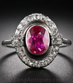 Burma No-Heat Vintage Ruby and Diamond Ring, A rich, luscious-red, oval Burma ruby, weighing 1.15 carats but presenting significantly larger due to its cut, floats inside a sparkling, rounded-edge platinum and diamond frame embellished with raised diamond-set epaulets on each side. The beautiful ring dates from the early-twentieth century and may be classified as either late-Edwardian or early-Art Deco.*