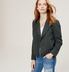 """Quilted panels rev up this modern moto, done in a brushed doublweave knit for easy riding. Notched lapel with snap trim. Long sleeves. Asymmetrical zip front. Welt pockets. Snap cuffs. Elasticized back hem. Lined. 22"""" long."""