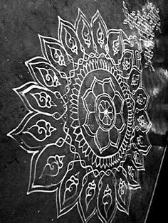 These kolams are drawn by women at the doorstep daily to protect those within from evil and to invite prosperity.