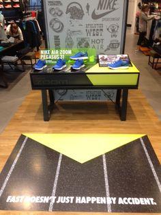 Nike Air Zoom Pegasus 31 - sports shoe table retail display.