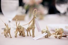 4-gold-spray-painted-plastic-animals-wedding-favors-glitter-guide