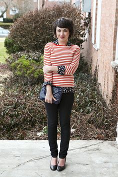 I have a red and white striped shirt like this. I like how she mixes patterns.