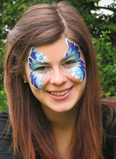 blue and purple butterfly face paint