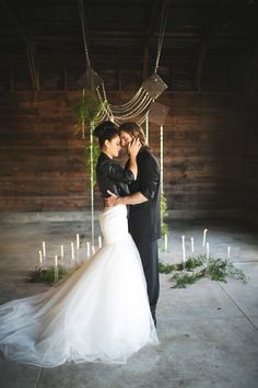 candles #ceremony #backdrop - photo by EE Photography - http://ruffledblog.com/rock-and-roll-chic-wedding-ideas/