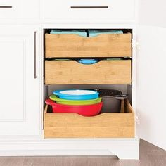 Enjoy free shipping on all purchases over $75 and free in-store pickup on the Bamboo Roll-Out Cabinet Drawers at The Container Store. Our Bamboo Pull-Out Cabinet Drawers bring the contents of your lower cabinets front and center without the expense of costly built-ins. They can be installed at the bottom or to the sides of the cabinet frame with the included hardware. The industrial-quality glides provide smooth and even functionality, even when fully loaded.