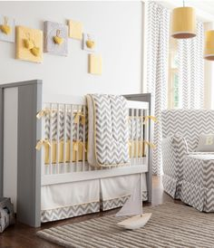 This is probably one of my favorite color combos, gray and yellow. I just redid the guestroom in these colors plus a sage green. What a cute and sophisticated nursery. That baby has great taste. (Probably a few too many chevron fabrics, would like to have seen some other patterns)
