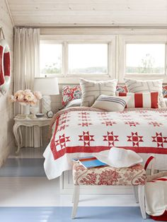 Subtly Patriotic.  Designer Sarah Richardson decorated this master bedroom from her summer cottage in red and white, adding liberal hues of blue.  Read more: Federal Era House American Flags - 4th of July Decorating - Country Living Follow us: @Country Living Magazine on Twitter | CountryLiving on Facebook Visit us at CountryLiving.com