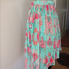 Forever 21 Floral Skirt Sweet high/low floral skirt from Forever 21 Exclusive. Small pleats all around the skirt. Skirt is 100% polyester with 100% polyester lining. XS. In very good condition. Rarely worn. No trades or Paypal please. Forever 21 Skirts