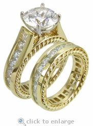 Cubic Zirconia Bridal Set 2.5 Carat Cushion Cut Wedding CZ Engagement Ring Set 14K Yellow Gold by Ziamond. The Yurma Wedding Set features channel set princess cut square cz highlighting a 2.5 carat cushion cut cubic zirconia. A beautiful rope like design adds to its uniqueness. $3295 #ziamond #cubiczirconia #cz #diamond #jewelry #cushioncut #princesscut #weddingset #bridalset #ring #solitaire #channelset #14kgold