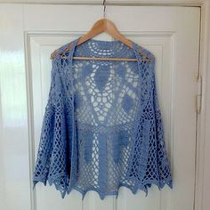 Beautiful lightweight summer shawl for cool nights. The pattern is based on an art deco stained glass window. Free crochet pattern.