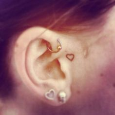 small ear tattoo. i might get this sometime soon. i LOVE it. and the top of the ear peircing.