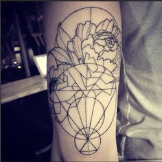 Jonah ellis. East side ink.  thin lines and dots and geometric flower tattoo.
