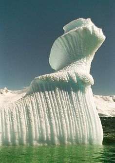 Spiral Iceberg in Antarctica...looks like a woman looking up into the sky