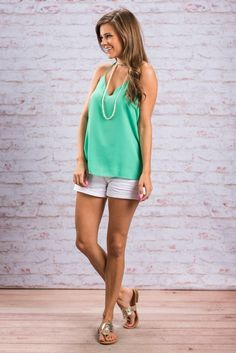 """""""By A String Tank, Green""""Is your patience for wardrobe hanging by a string? Simply add this little green number to spice things up! #newarrivals #shopthemint"""