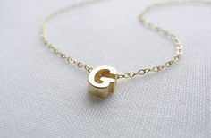 GroopDealz | Tiny Gold Initial Necklace - just purchased a C for Cooper :)  He broke my silver stella + dot one.