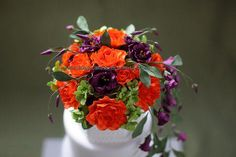 Sugar flowers - orange roses, violet lisianthus and lime green hydrangeas.