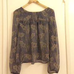 Beautiful chiffon style top Sheer chiffon style top with beautiful floral pattern and lace back. Beautiful purple and grey top Tops