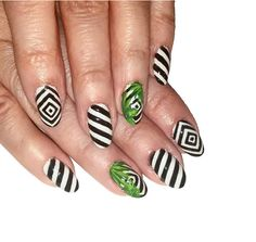 Striped nail art is a huge trend for Summer.