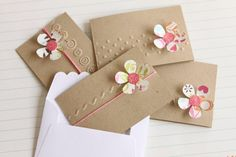 Note Cards with Simple Flower  Like the combo of embossing and simple flower cutouts