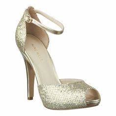 Nine West:  peep toe pump with ankle strap.  A little high of a heel, but the ankle strap probably makes it bearable.
