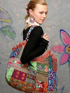 "Emporium Patchwork Tote | Large embroidered patchwork bag with ric rac trim and braided straps.  Three interior pockets one with zip closure. Sizing info:  13"" x  24"""