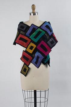 Jenna Scarf by Elizabeth Rubidge . Geometric blocks of silk and wool are hand felted onto a backdrop of sheer silk. Dramatic cut edges add to the piece's statement-making appeal.