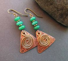 These copper earrings are inspired by ancient Celtic jewelry designs. Each earring begins with 3 green chalcedony gemstones. The dangles are hand