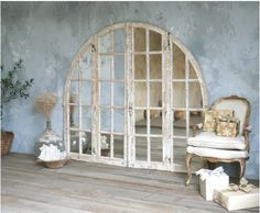 Arched French mirrored doors - fantastic!  (from The French Garden)