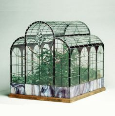 A miniature greenhouse. The creative possibilities for containers is endless!
