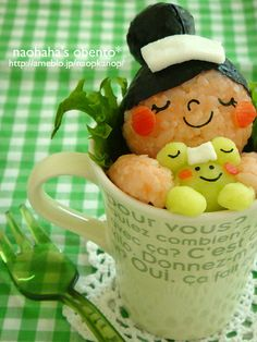 Kawaii Onigiri Rice Cake in a Cup by Naohaha yaraben or charaben , a shortened form of character bento , is a style of elaborately arranged bento which features food decorated to look like people, characters from popular media, animals, and plants. Japanese homemakers often spend time devising their families' meals, including their boxed lunches. Originally, a decorated bento was intended to interest children in their food and to encourage a wider range of eating habits.