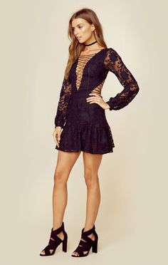 The For Love and Lemons Jolene Lace Up Dress creates the perfect balance of sweet and sexy with its bold lace up detailing in the front and back, tule fabrication with floral embroidery throughout, an