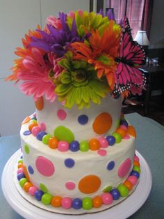 Gerber Daisy/Polka Dot - I made this cake for a little girls first birthday, so they wanted it girly and fun.  Gerber daisies and butterflys are not real. Polka dots and pearls are fondant. WASC with buttercream icing. Thanks for looking:)