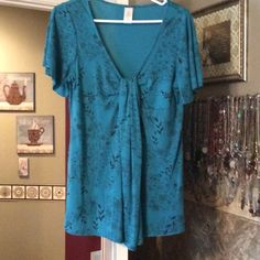 Size - M Teal Blue Babydoll Blouse Teal blue with black floral sketches.  Babydoll style. Avon Tops Blouses