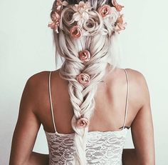 Blonde silver wedding hairstyle. Braided French with roses. So pretty