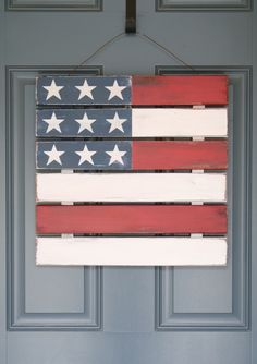 American flag door hanging made out of a mini-pallet purchased at a craft store. This link has full instructions for how to recreate this - love it!