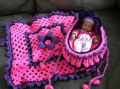 Crocheted baby doll cradle purse in Pink and Purple.