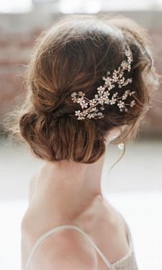 wedding updo hairstyle with flower gold hairpiece
