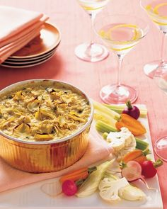 Bring a sense of indulgence to your holiday gathering with a warm, bubbling artichoke dip and an assortment of winter-vegetable crudites.Martha Stewart Living, 2007