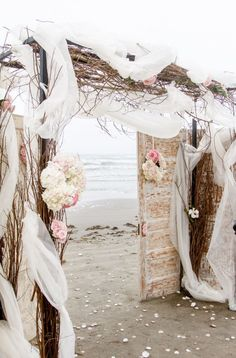 Using natural textures, this wedding arch makes a romantic statement in a beach wedding.